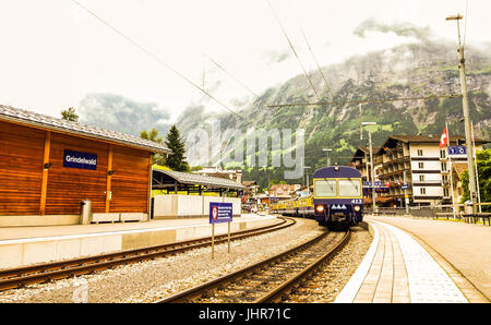 View of train from Grindelwald train station in swiss alpine Jungfrau region, Grindelwald, Bernese Oberland, Bern - Stock Photo