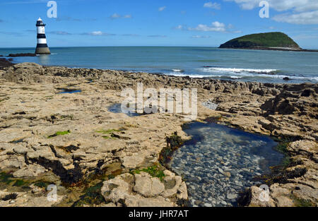 Trwyn Du Lighthouse and Puffin Island from Penmon Point, Anglesey, Wales, UK - Stock Photo