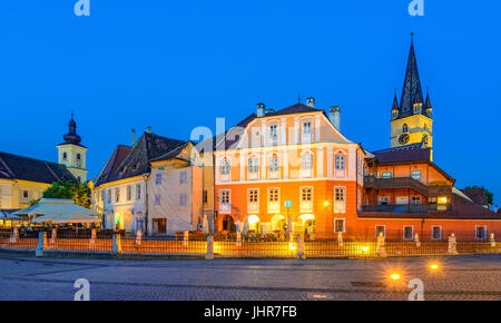 Lutheran Cathedral, seen from the Small Square with Huet Square, medieval Saxon city of Sibiu, Transylvania, Romania - Stock Photo