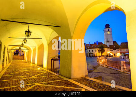 Twilight image of Council Tower in Small Square, downtown of Sibiu,    Transylvania, Romania. - Stock Photo