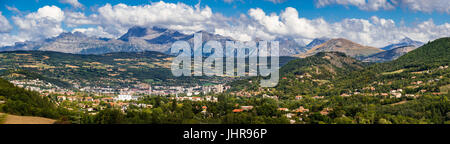 The city of Gap in the Hautes Alpes with surrounding mountains and peaks in Summer. Panoramic. Southern French Alps, - Stock Photo