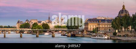 Summer view on Ile de la Cité with the Pont des Art and the Institut de France (French Academy) at dusk. Paris, - Stock Photo