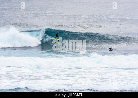 Surfers at Margaret River's Surfers Point, Prevelly, Western Australia - Stock Photo