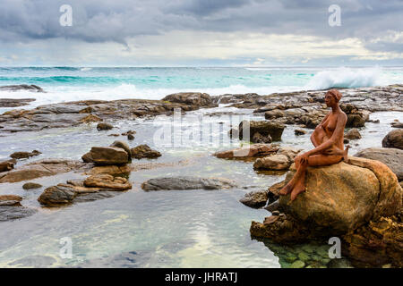 The rock pools near Margaret River river mouth with Russell Sheridan's Layla public art sculpture on a rock, Prevelly, - Stock Photo