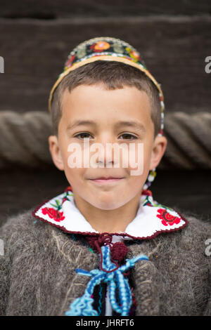 People in traditional costume at 'Udatoriul' old agrarian custom on Easter Monday, Surdesti, District of Maramures, - Stock Photo