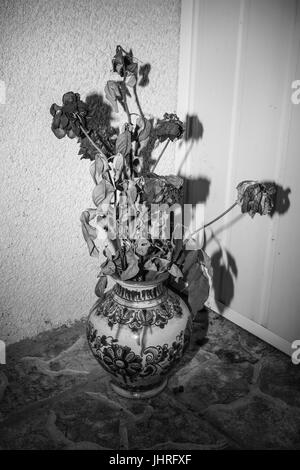 Photograph of a bouquet of flowers in an old vase - Stock Photo