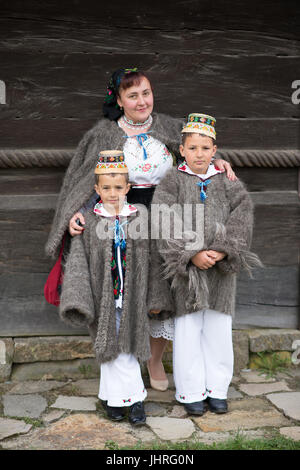 Mother and childs in traditional costume at 'Udatoriul' old agrarian custom on Easter Monday, Surdesti, District - Stock Photo