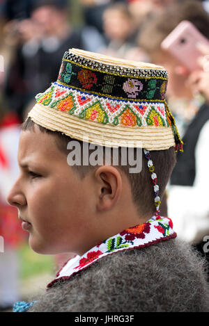 Boy in traditional costume at 'Udatoriul' old agrarian custom on Easter Monday, Surdesti, District of Maramures, - Stock Photo