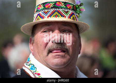 Man with traditional beaded straw hat at 'Udatoriul' old agrarian custom on Easter Monday, Surdesti, District of - Stock Photo