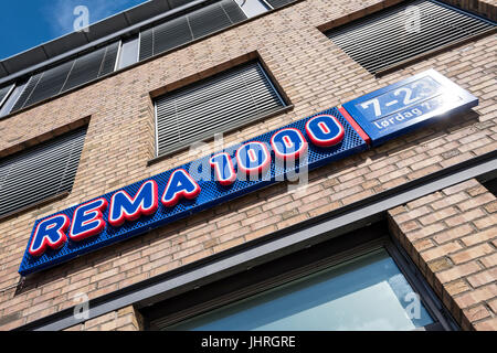 REMA 1000 sign at branch. REMA 1000 is a Norwegian no-frills supermarket chain with businesses in Norway and Denmark. - Stock Photo