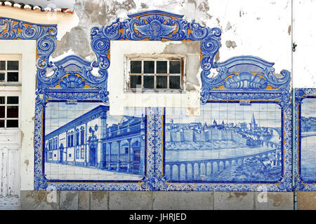 Decorative tile wall blue Azulejos on the old train station Aveiro Portugal - Stock Photo