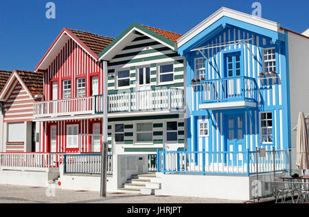Colorful candy striped cottages in Costa Nova near Aveiro Portugal - Stock Photo