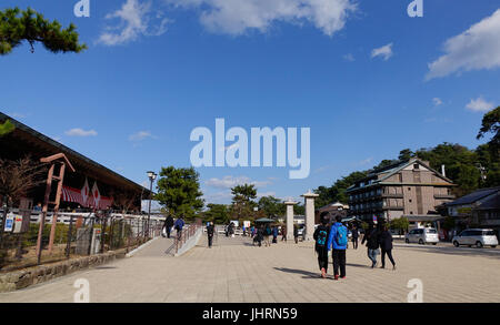 Hiroshima, Japan - Dec 28, 2015. Tourists walking on street in Miyajima island, Japan. Miyajima is famous for the - Stock Photo