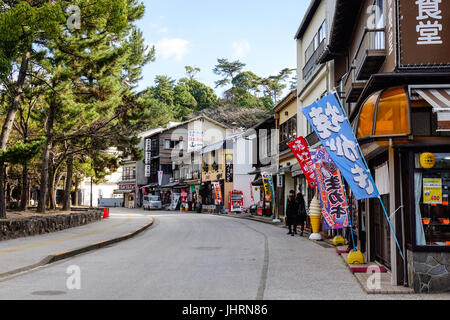 Hiroshima, Japan - Dec 28, 2015. Many shops on street in Miyajima island, Hiroshima, Japan. Miyajima is an island - Stock Photo