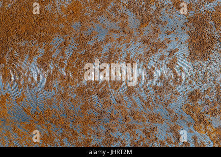 An abstract metal background with signs of wear and rust. Macro shot of metal surface. - Stock Photo
