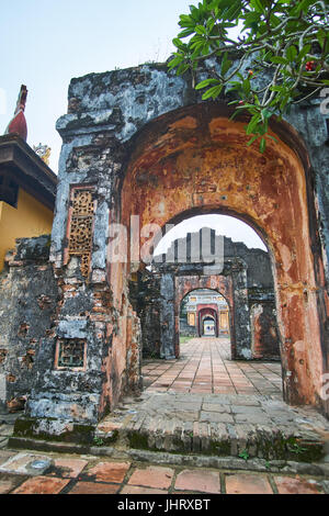 Traditional vietnamese entrance door in the imperial city, Hue, Vietnam, on a foggy day. - Stock Photo