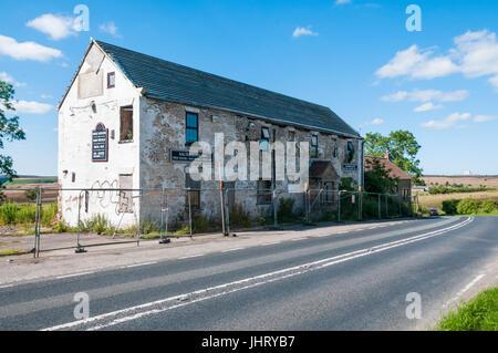 The semi-derelict Saltersgate Inn closed public house, a landmark on the A169 road across the North York Moors. - Stock Photo
