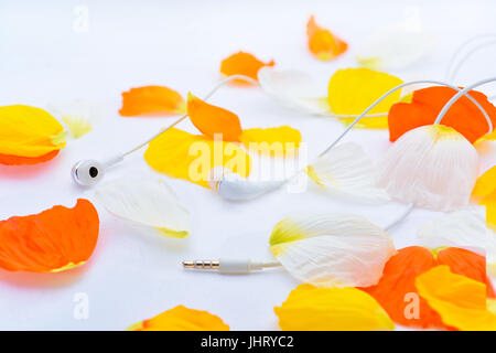 Music abstraction. Autumn texture with white headphones - Stock Photo