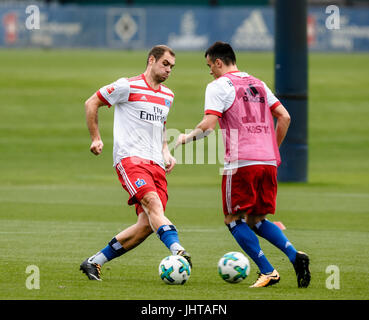 Hamburg, Germany. 16th July, 2017. Pierre-Michel Lasogga (M) and Filip Kostic of the German Bundesliga Team Hamburger - Stock Photo