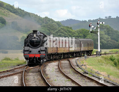 Steam locomotive in the Dee valley approaching Carrog station, Standard class 4 tank engine steam train, part of - Stock Photo