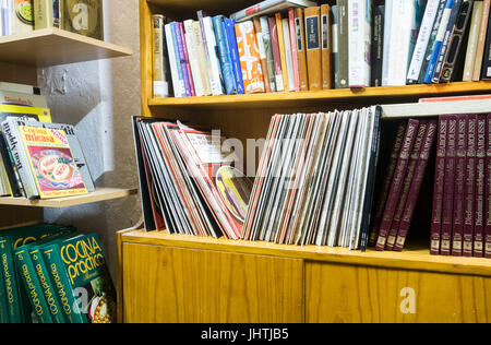 Vinyl records and second hand books in charity shop in Spain - Stock Photo