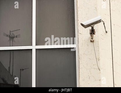 CCTV camera on building. - Stock Photo