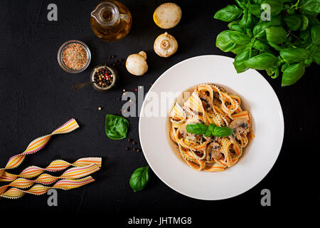 Colorful Pasta pappardelle with mushrooms in cream sauce. Flat lay. Top view - Stock Photo