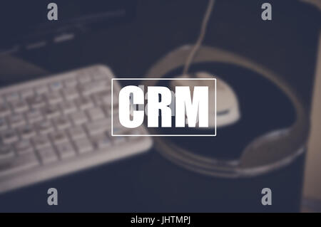 crm word with blurring business background, customer relationship management concept - Stock Photo