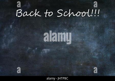 Dusty blank school chalkboard or blackboard with room for copy space. - Stock Photo