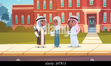 Group Of Arab Pupils Stand In Front Of School Building Primary Muslim Schoolchildren Talking Students - Stock Photo
