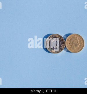 old and new one pound coins - Stock Photo