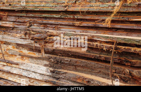 Rough cut planks stacked in a pile - Stock Photo