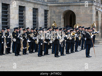AMSTERDAM, APRIL 30-2013: Brass band plays  in Amsterdam during the inauguration of prince willem alexander to King - Stock Photo