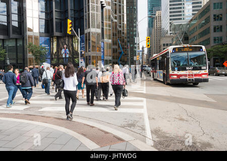Toronto, Canada - 26 June 2017: A crowd of people crossing Front street in Downtown Toronto - Stock Photo