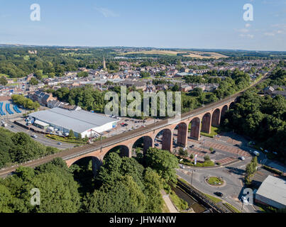 Aerial view of a railway viaduct running by a Tesco grocery store in Chester-le-street, Co. Durham - Stock Photo