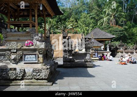 Balinese praying at Pura Tirta Empul Temple, Tampaksiring, Bali, Indonesia - Stock Photo