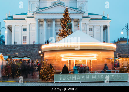 Helsinki, Finland - December 11, 2016: Xmas Market On Senate Square With Holiday Carousel And Famous Landmark Is - Stock Photo