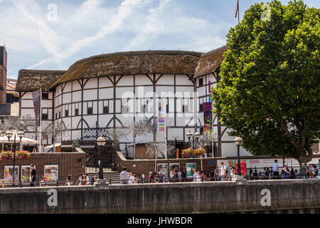 People on Bankside, the River Thames waterfront in front of Shakespeare's Globe Theatre, central London, on a hot - Stock Photo