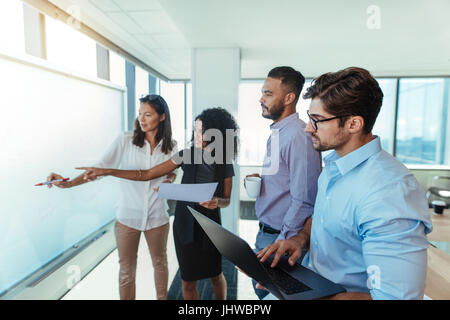 Women entrepreneurs discussing business ideas in boardroom with their colleagues. Young business investors presenting - Stock Photo