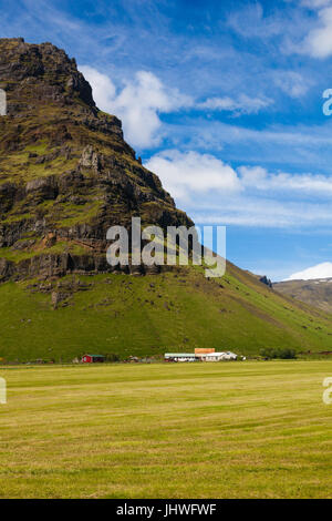Farm buildings close to the Eyjafjallajokull volcano which erupted in April of 2010 in Iceland - Stock Photo