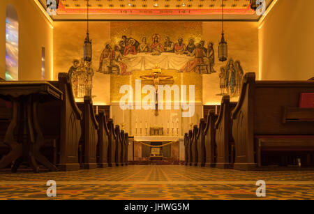 This low angle view of the side chapel in the Cathedral Basilica of St. Augustine in Florida, USA, shows the altar - Stock Photo