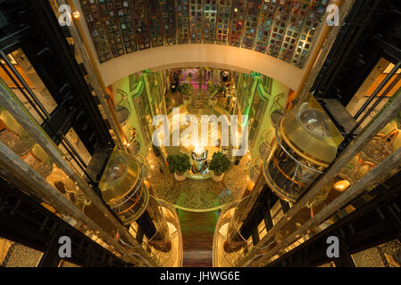 View of the elevator shafts, elevators, lobby and staircases in the cruise ship Navigator of the Seas (Royal Caribbean - Stock Photo