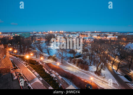 Tallinn, Estonia - December 4, 2016: Old Stone Staircase And Cityscape At Winter Evening Night. View From Patkuli - Stock Photo