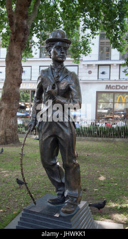 Bronze statue of Charlie Chaplin as The Little Tramp (1979-81 by John Doubleday) in Leicester Square in central - Stock Photo