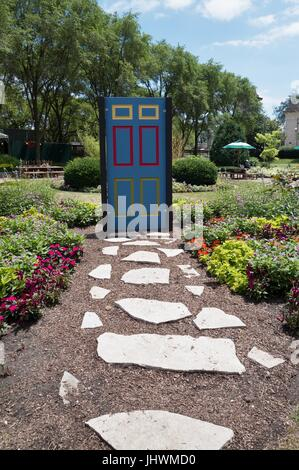 A brightly painted door sculpture in Grant Park in Chicago, IL, USA. - Stock Photo
