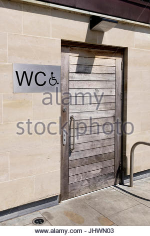 Looking towards the sign and door of  the toilet for the disabled in Salisbury Market Place, Wiltshire - Stock Photo