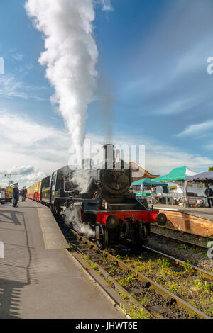 Ex-BR loco 78018 waits to depart from Bishops Lydeard station with a train to Minehead on the West Somerset Railway, - Stock Photo