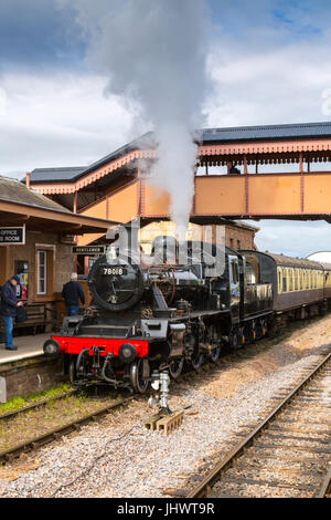 Ex-BR loco 78018 waits to depart from Williton station with a train to Bishops Lydeard on the West Somerset Railway, - Stock Photo