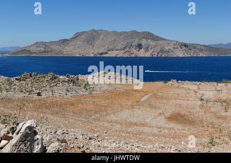 Symi Island, South Aegean, Greece - evidence of small-scale agriculture is visible in the hills above Pedi and elsewhere - Stock Photo