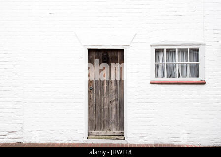 White Front Door Texture wooden front door and window on a typical cotswold stone house in